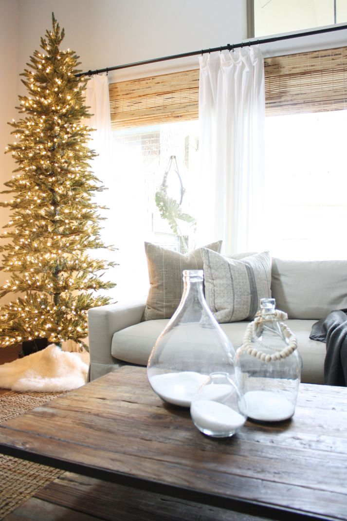 neutral living room with simple christmas tree with no ornaments