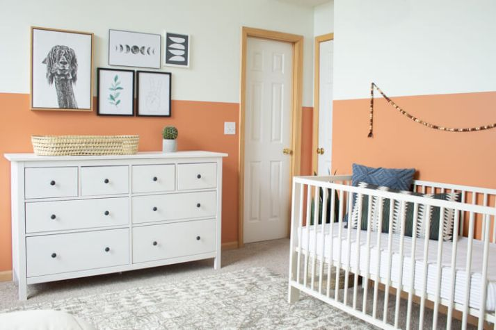 eclectic nursery with color blocked walls in terra cotta