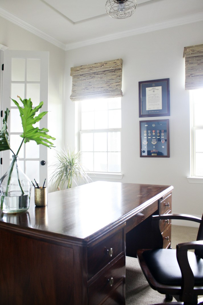 traditional office with woven wood shades mounted outside window opening on wall above to make windows look taller