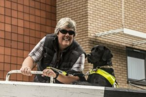 Tracey and Guide Dog Oakley working a lock beam together in September 2014.