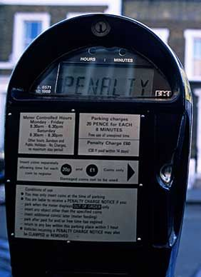 "Close up of a Parking Meter with the electronic display saying ""Penalty""."
