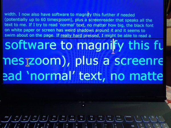 PC screen set to cyan on blue, large text with magnifier.