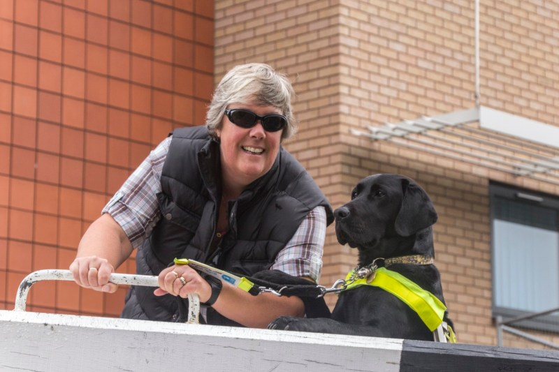 "Tracey, with Guide Dog Oakley ""helping"" out at a lock beam!"