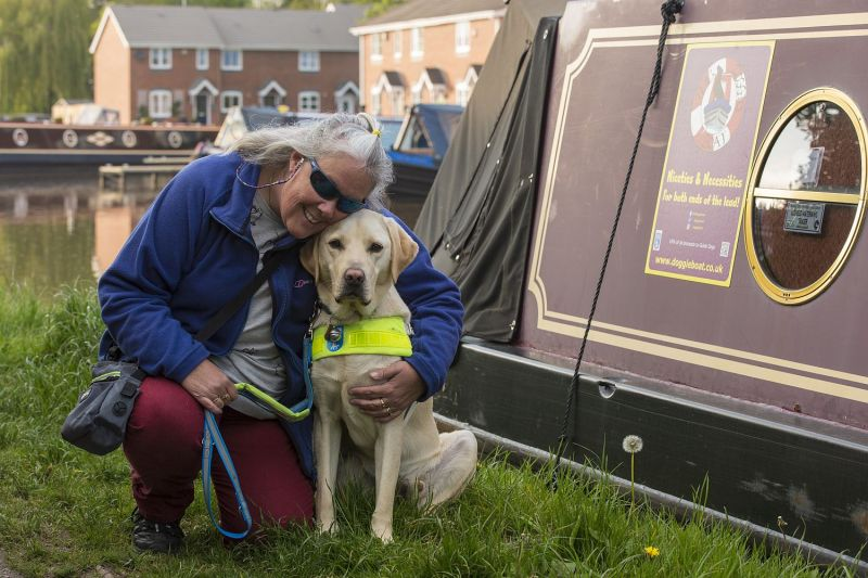 Tracey and Loki alongside the boat phhotographed on the day they became a qualified partnership.