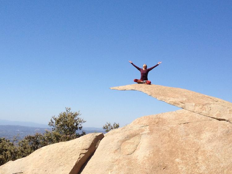Blissful yogini sunning on a rock.