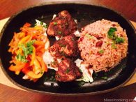 Sizzling Jamaican Platter with cottage cheese and Jamaican rice
