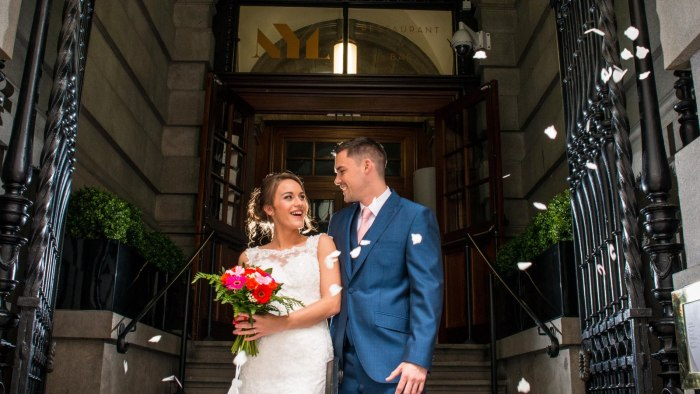 Married couple at the entrance to Aloft Liverpool
