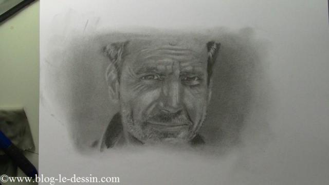 Un portrait d'homme dessiné avec les crayons et les estompes.