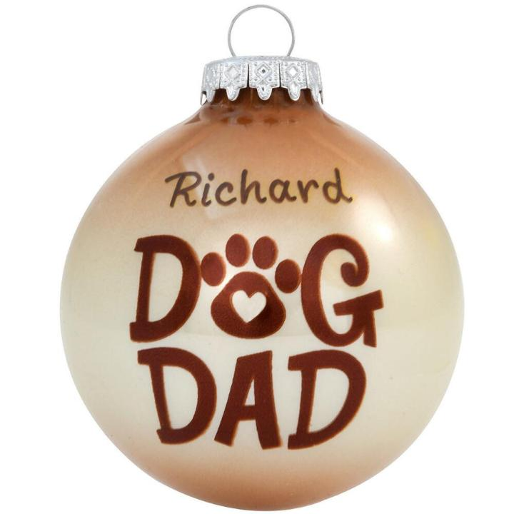"""Two-tone beige and brown ornament with the words """"Dog Dad"""" and a paw print that can be personalized with name"""
