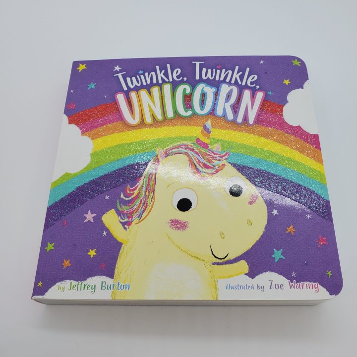 "Colorful board book ""Twinkle, Twinkle, Unicorn"" with rainbow, unicorn, clouds and stars on the cover"