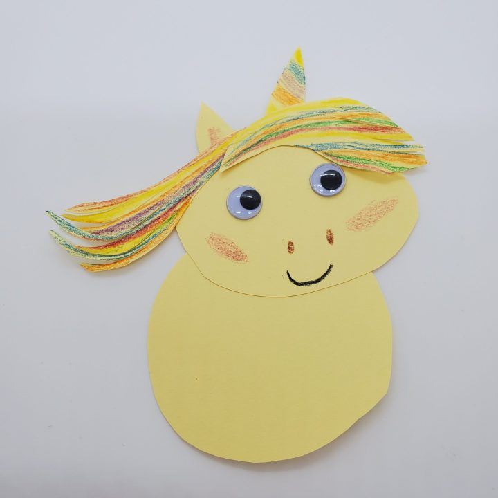 DIY unicorn finger puppet with eyes, mane, ear and horn attached