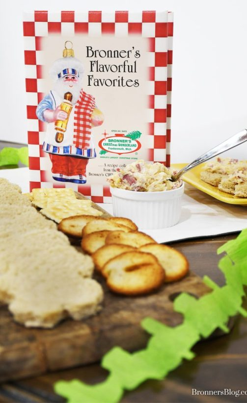 """Bronner's Flavorful Favorites"" staff cookbook is featured in the photo along with the reuben spread accented with a shamrock garland."