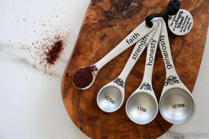 """Amazing Woman set of four measuring spoons with the words """"faith,"""" """"strength,"""" """"honesty"""" and """"generosity"""" on them."""