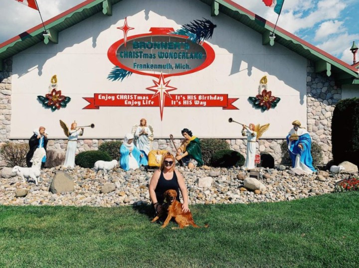Red Golden Retriever therapy dog with Bronner's nativity.