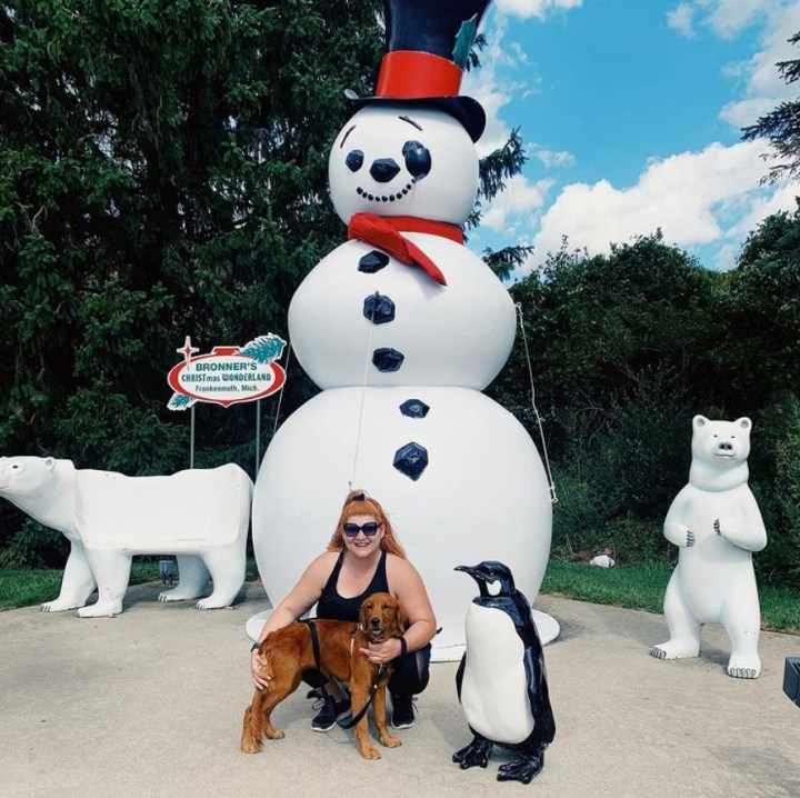 Red Golden Retriever with Bronner's Larger-Than-Life Snowman.
