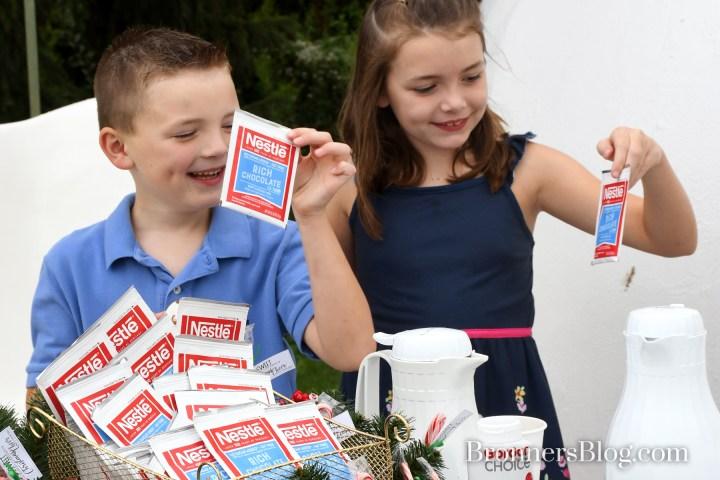 Kids grabbing Nestle hot chocolate packet