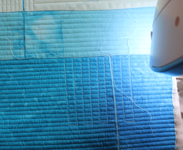 turquoise art quilt in process