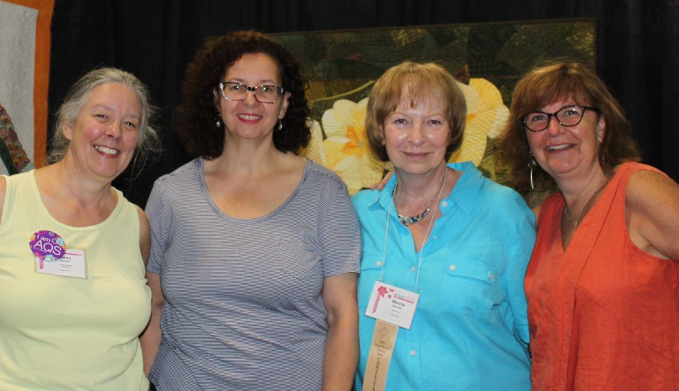 Helen, Doris, Marcia and Jeanne with Primroses at the AQS show Syracuse