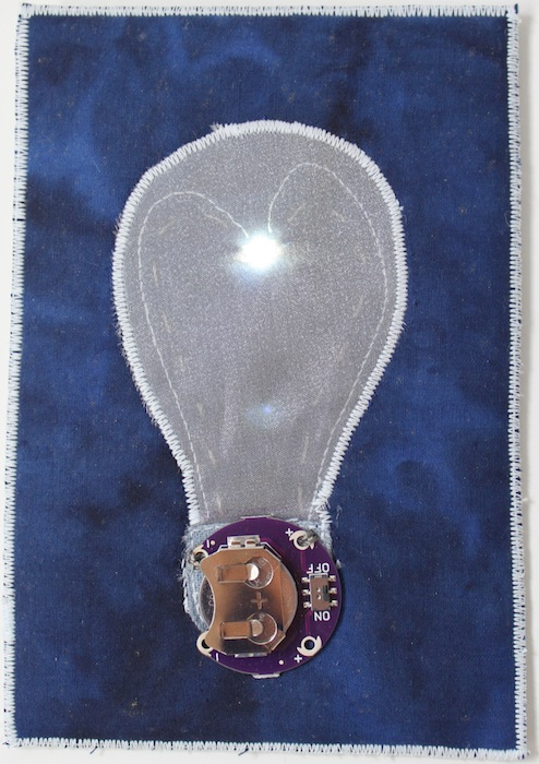 Light bulb postcard with LED light on
