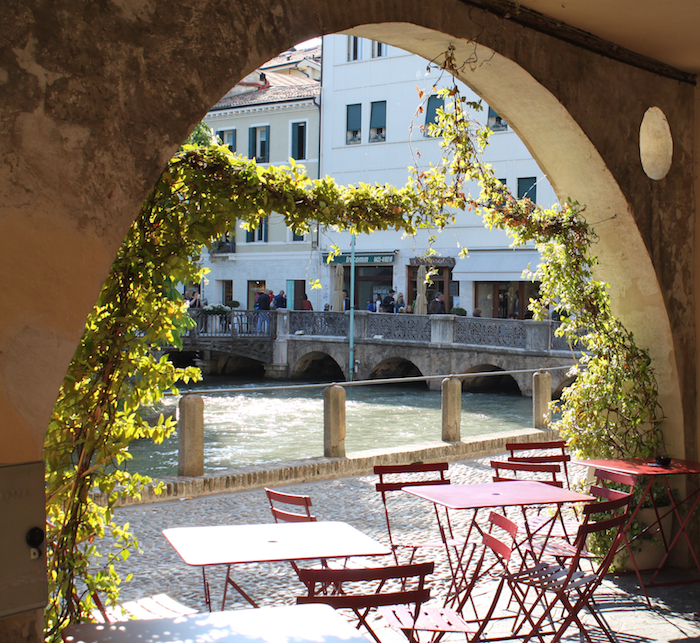 The Sile River through an archway in Treviso, italy