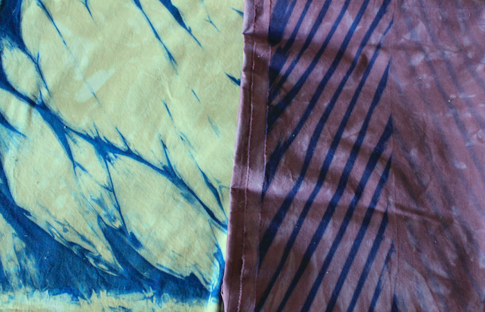 shibori indigo dyed cotton overdyed in purple and the other in green