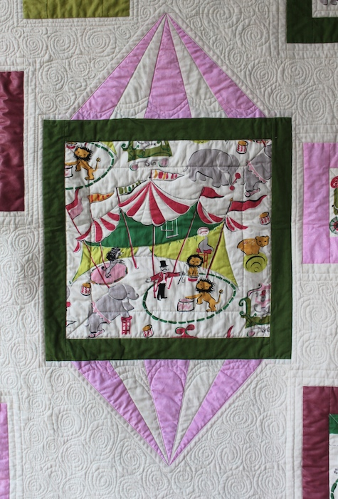 Ringmaster and circus tent of modern baby quilt by Doris Lovadina-Lee