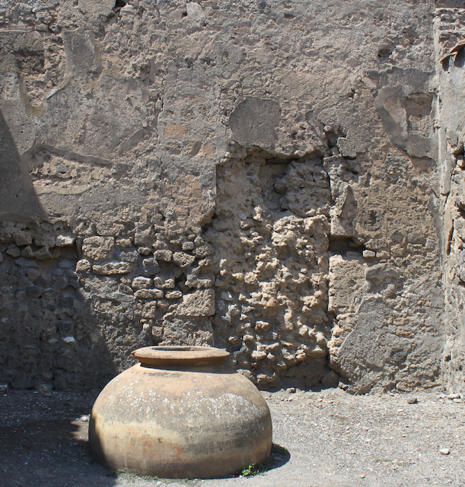 urn and stone wall in italy