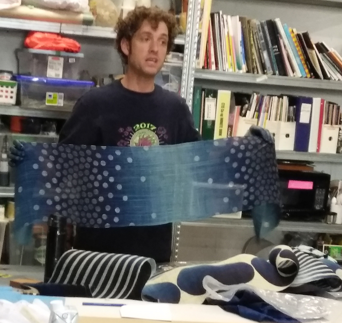 Roland Ricketts showing his indigo dyed table runner