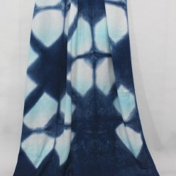 viscose shawl in turquoise is overdyed in indigo with itajime shibori technques to create a luxurious cover up made in canada