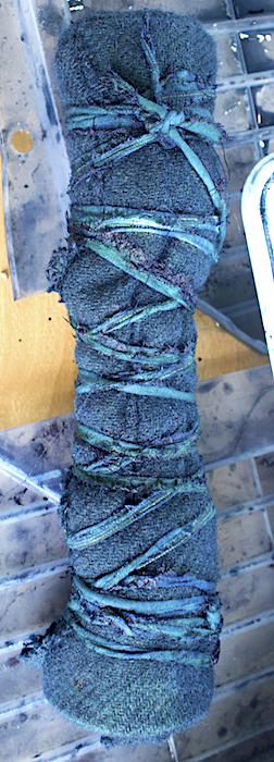 indigo dyed wool rolled up and tied with string by doris lovadina-lee toronto dyer