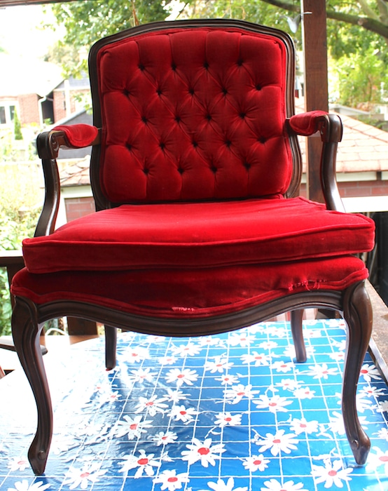red velvet french provincial armchair