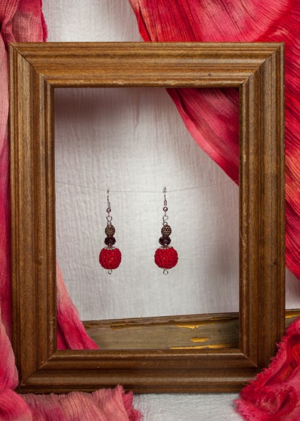 Pair of red crochet earrings in frame with beads by Maria designs