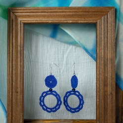 an open and closed royal blue cotton crocheted earings by maria nunes artist
