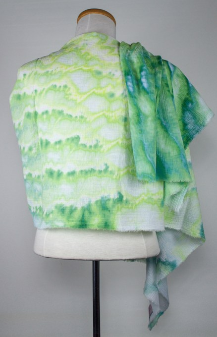 back of Spring Buds scarf cotton gauze in soft greens yellows and turquoise