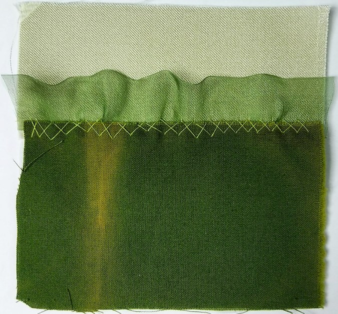 Day 35 of the 100 day stitch meditation project a 5 inch square of repurposed silk, hand dyed green cotton and organza ribbon