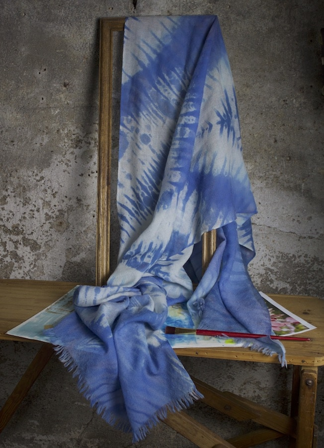 blue wool arashi shibori scarf draped on wooden frame a one-of-a-kind gift for women