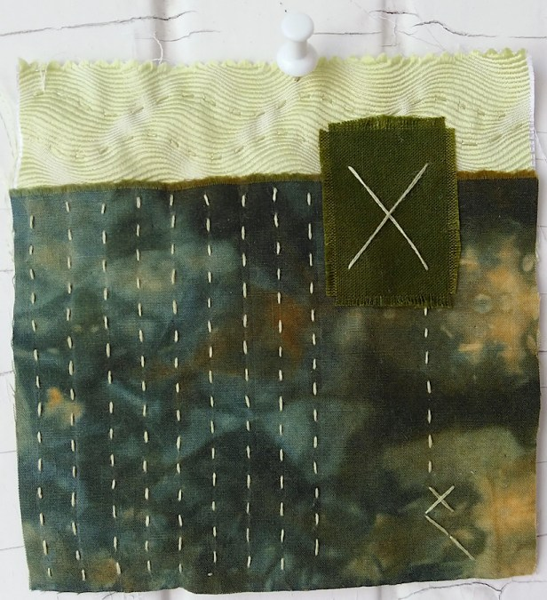 yellow and green scraps embroidered with running and cross stiches with handdyed perle cotton stitched by doris lovadina lee toronto artist