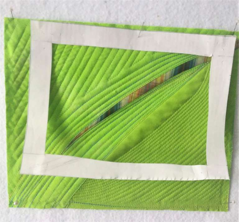green art quilt painting with a white frame hanging on wallby toronto artist doris lovadina=lee
