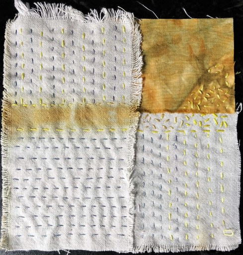 "5"" stitch meditation week 57 a mustard coloured stripe of dye on sand coloured cotton held together with running stitches of yellow and purple thread. top left quadrant all mustard with yellow embroidery stitches."