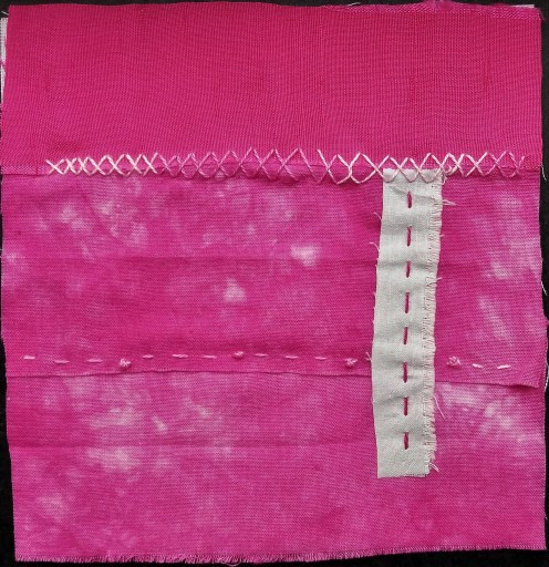 five inch square of three strips of fuchsia hand dyed fabric and repurposed silk stitched with embroidery cotton and a narrow cotton strip created by doris lovadina-lee canadian textile artist