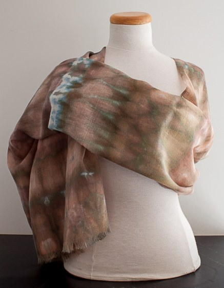 light brown patterned wool scarf draped on a judy