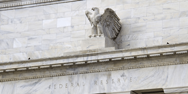 Fed turns more dovish and signals an end to rate hikes