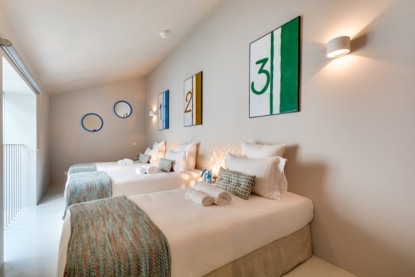 3 single beds for kids in one of the bedrooms of this quiet townhouse in the heart of Paris designed by Sweet Inn