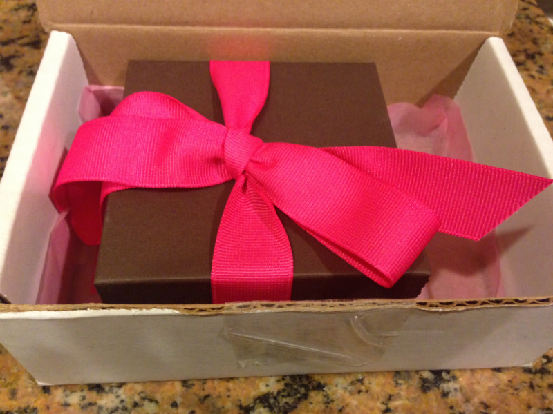 Brown box with big pink bow
