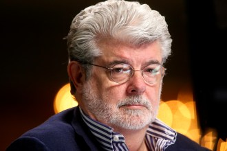 """Filmmaker and Chairman of the Board of Lucasfilm Ltd. George Lucas waits to do a television interview at the Milken Institute Global Conference in Beverly Hills, California April 30, 2012. Walt Disney Co said it agreed to buy film maker George Lucas's Lucasfilm Ltd for $4.05 billion, according to news reports on October 30, 2012. Disney will pay about half in cash and issue about 40 million shares at closing for the acquisition of the film studio known for the iconic """"Star Wars"""" movies. Picture taken April 30, 2012. REUTERS/Fred Prouser (UNITED STATES - Tags: BUSINESS ENTERTAINMENT MEDIA HEADSHOT) - RTR39SE4"""