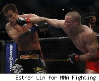 GSP punches Jake Shields at UFC 129.