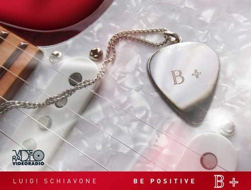 Copertina del disco di Luigi Schiavone, Be Positive, con un pendaglio a cuore con scritto B+