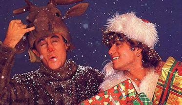 Gli Wham! con George Michael nella copertina di Last Christmas