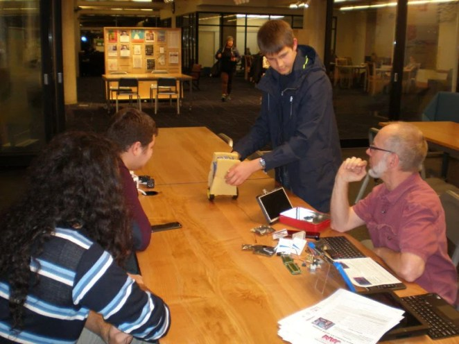 Alex Mous shows off his self-balancing robot to Seattle Raspberry Jam members