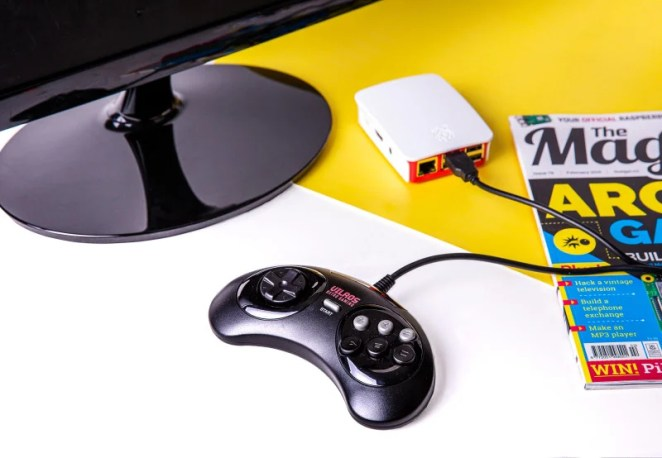 If using a wireless gamepad, insert its dongle into one of Raspberry Pi's USB ports, insert the batteries, and turn it on. Press the Start button on the gamepad and it will light up.